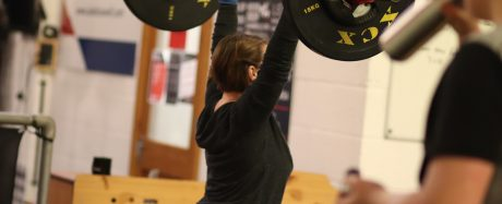 Alison performing a jerk in a CrossFit class