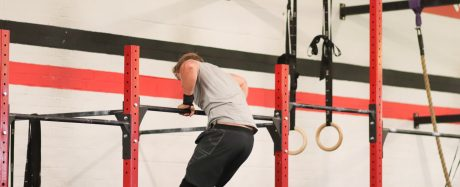 Ed Dixon doing a bar muscle up