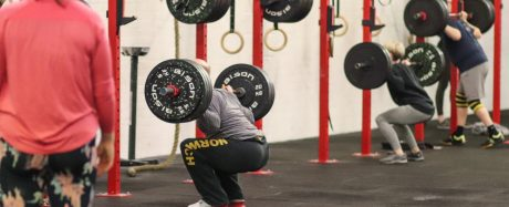 Ed English doing a back squat