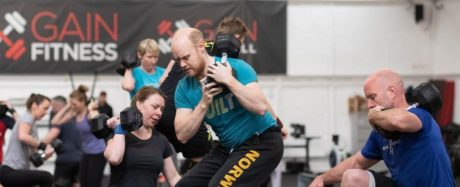 Ed English from GAIN Fitness Norwich performing dumbbell box step overs