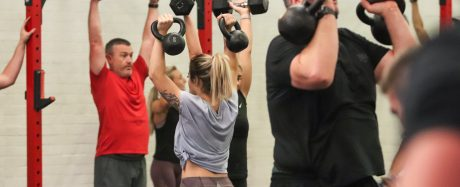 Emma with a pair of dumbbells